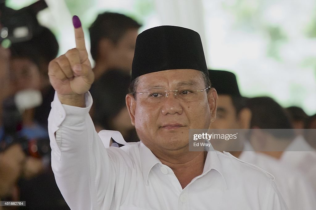 Indonesian presidential candidate <a gi-track='captionPersonalityLinkClicked' href=/galleries/search?phrase=Prabowo+Subianto&family=editorial&specificpeople=3051840 ng-click='$event.stopPropagation()'>Prabowo Subianto</a> shows ink-stained finger after voting in his local polling station on July 9, 2014 in Bojong Koneng, Indonesia. Indonesians went to the polls today to vote in the country's presidential election being contested by two candidates - <a gi-track='captionPersonalityLinkClicked' href=/galleries/search?phrase=Prabowo+Subianto&family=editorial&specificpeople=3051840 ng-click='$event.stopPropagation()'>Prabowo Subianto</a>, a former military General and Joko Widodo, the former governor of Jakarta.