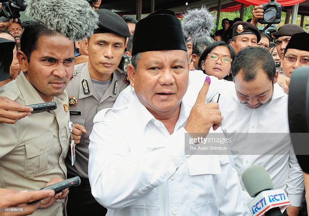 Indonesian Presidential Candidate <a gi-track='captionPersonalityLinkClicked' href=/galleries/search?phrase=Prabowo+Subianto&family=editorial&specificpeople=3051840 ng-click='$event.stopPropagation()'>Prabowo Subianto</a> speaks with reporters after voting in his local polling station on July 9, 2014 in Bojong Koneng, Indonesia. Indonesians went to the polls today to vote in the country's presidential election being contested by two candidates - <a gi-track='captionPersonalityLinkClicked' href=/galleries/search?phrase=Prabowo+Subianto&family=editorial&specificpeople=3051840 ng-click='$event.stopPropagation()'>Prabowo Subianto</a>, a former military General and Joko Widodo, the former governor of Jakarta.