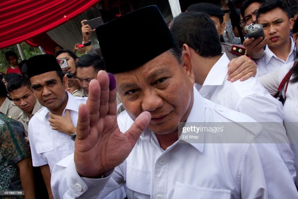 Indonesian presidential candidate <a gi-track='captionPersonalityLinkClicked' href=/galleries/search?phrase=Prabowo+Subianto&family=editorial&specificpeople=3051840 ng-click='$event.stopPropagation()'>Prabowo Subianto</a> waves with an ink-stained finger after voting in his local polling station on July 9, 2014 in Bojong Koneng, Indonesia. Indonesians went to the polls today to vote in the country's presidential election being contested by two candidates - <a gi-track='captionPersonalityLinkClicked' href=/galleries/search?phrase=Prabowo+Subianto&family=editorial&specificpeople=3051840 ng-click='$event.stopPropagation()'>Prabowo Subianto</a>, a former military general and Joko Widodo, the former governor of Jakarta.