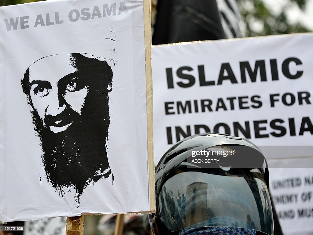 Indonesian protesters from a group called 'Sharia For Indonesia' hold up a placard showing late terrorist leader Osama bin Laden (L) during a demonstration against the US government to mark the anniversary of the 9/11 attacks, outside the US embassy in Jakarta on September 11, 2012. Hundreds of people took part in the rally to condemn the US government's perceived policy on how it handles Muslim countries around the world.
