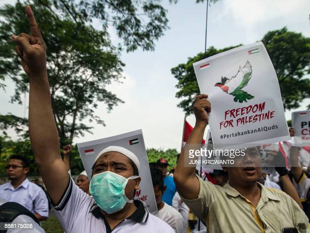 Indonesian protesters shout slogans during a protest in front of the US consulate general in Surabaya East Java province on December 8 against US...