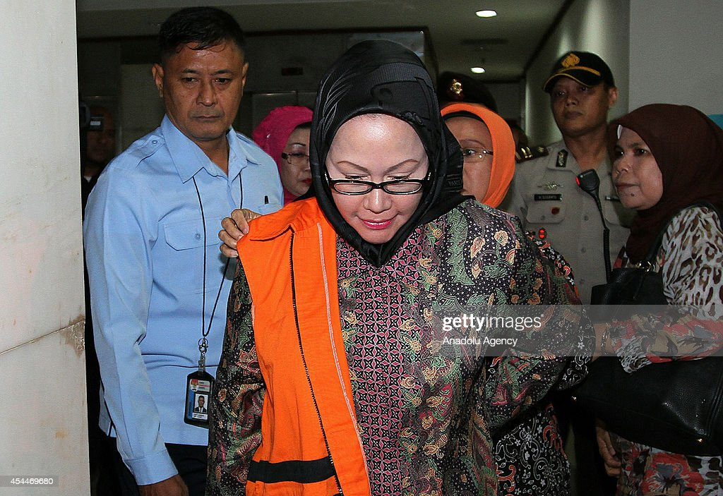 Indonesian Ratu Atut Chosiyah is escorted by officials prior to her trial in Jakarta, Indonesia on September 1, 2014. Indonesia's first female provincial leader, and head of one of the country's most powerful political dynasties, was jailed for four years on September 1, for bribing a top judge over an election dispute.