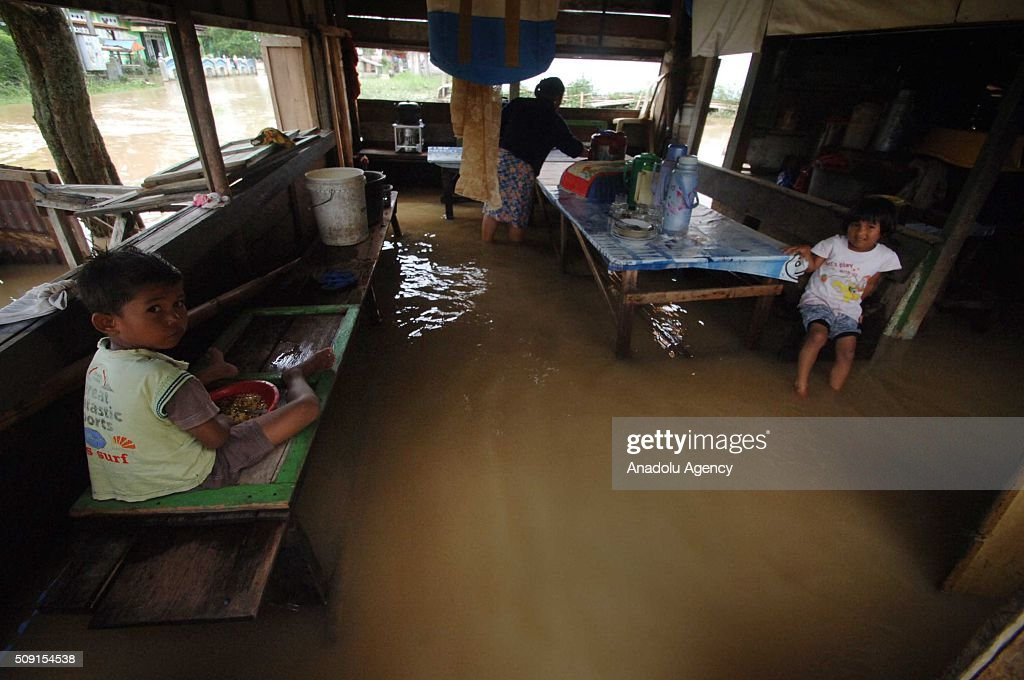 Indonesian residents are seen after torrential rains caused floods at Pangkalan village on February 09, 2016 in Lima Puluh Koto regency, West Sumatra Province, Indonesia. More 1000 houses submerged, 5000 residents were evacuated.