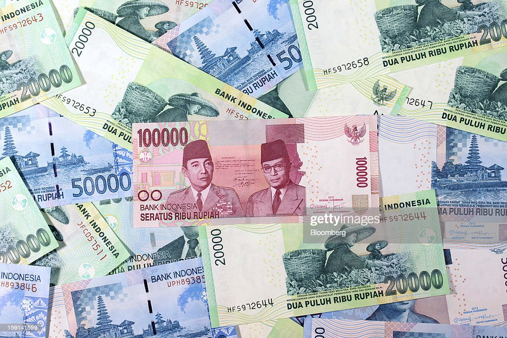 Indonesian rupiah banknotes of various denominations are arranged for a photograph in Jakarta, Indonesia, on Tuesday, Jan. 8, 2013. Indonesia's rupiah weakened by the most in six months on concern the government's failure to meet its spending target last year will hamper economic growth and damp demand for local assets. Photographer: Dimas Ardian/Bloomberg via Getty Images