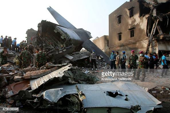 Indonesian search and rescue teams work at the site of an Indonesian military C130 Hercules aircraft crash in Medan on June 30 2015 An Indonesian...