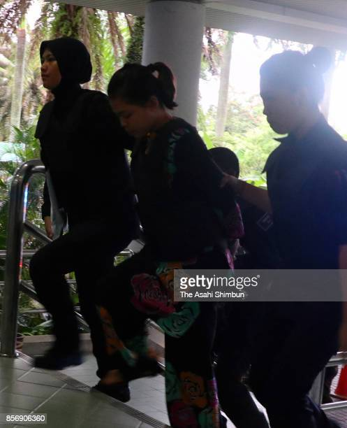 Indonesian Siti Aisyah is seen on arrival at Shah Alam court house on October 2 2017 in Kuala Lumpur Malaysia Court hearing begins for murdered Kim...