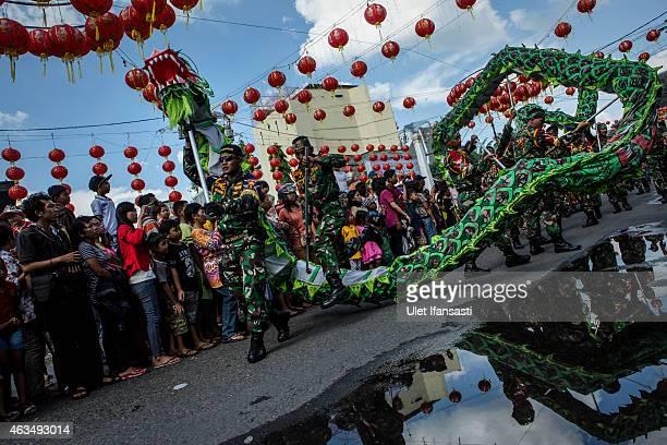 Indonesian soldiers perform dragon dancer during Grebeg Sudiro festival on February 15 2015 in Solo City Central Java Indonesia Grebeg Sudiro...