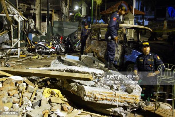 Indonesian soldiers stand guard over the normally bustling Legian Street in Kuta Bali at 1130pm exactly one week on from the car bomb attack on the...