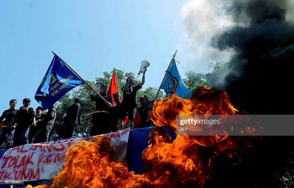 Indonesian students shout slogans in the back of a truck and burn tyres during a protest against the government's plan to increase fuel prices in Makassar on April 30, 2013. Indonesian President Susilo Bambang Yudhoyono said April 30, he hopes to lower fuel subsidies that are a risk to Southeast Asia's top economy as soon as May, in a new bid to tackle the flashpoint issue.