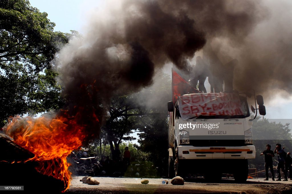 Indonesian students stop a truck and burn tyres during a protest against the government's plan to increase fuel prices in Makassar on April 30, 2013. Indonesian President Susilo Bambang Yudhoyono said April 30, he hopes to lower fuel subsidies that are a risk to Southeast Asia's top economy as soon as May, in a new bid to tackle the flashpoint issue.