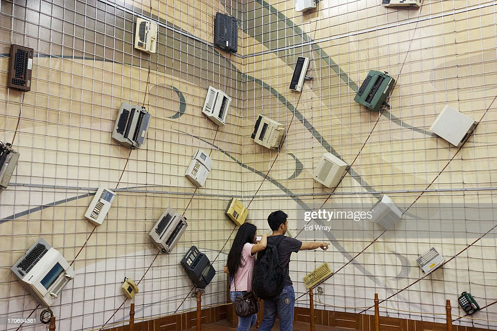 Indonesian tourists look at a display of old office machinery at the Museum Mandiri banking museum in Kota Tua Sunday June 16, 2013 in Jakarta, Indonesia. Once known as the 'Queen of the East', Kota Tua, which means Old Town in Indonesian, is the original city of Jakarta built by the Dutch in the 16th century and called Batavia at that time. Currently, Kota Tua's beautiful Colonial architecture is in ruins, abandoned as the city edged farther south over the years. Jakarta's Governor, Joko Widodo, hopes to make it a priority to restore the old town and develop it into a high end tourist destination..