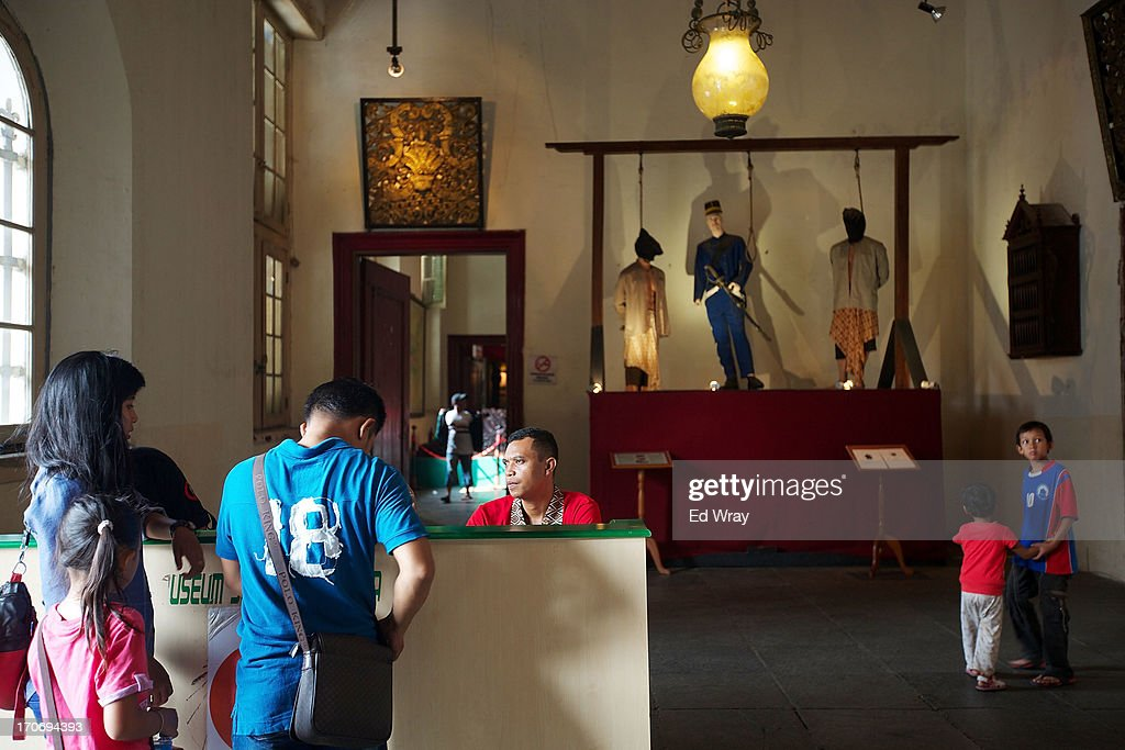 Indonesian tourists pay to enter the National History museum in Kota Tua Sunday June 16, 2013 in Jakarta, Indonesia. Once known as the 'Queen of the East', Kota Tua, which means Old Town in Indonesian, is the original city of Jakarta built by the Dutch in the 16th century and called Batavia at that time. Currently, Kota Tua's beautiful Colonial architecture is in ruins, abandoned as the city edged farther south over the years. Jakarta's Governor, Joko Widodo, hopes to make it a priority to restore the old town and develop it into a high end tourist destination..