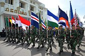 Indonesian troops bearing flags of participating Asian and African nations march past Gedung Merdeka in Bandung on western Java island on April 23...