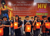 Indonesian volunteers hold lanterns during a candlelight vigil to mark World AIDS Day in Jakarta on December 1 2009 Calls for an end to...
