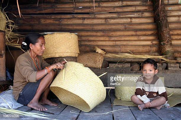 Indonesian Woman and Boy Weaving Baskets