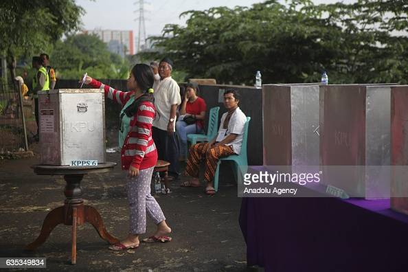 Indonesian woman casts her ballot during election day to elect Jakarta Governor to a fiveyear term in Jakarta Indonesia on February 15 2017 Incumbent...