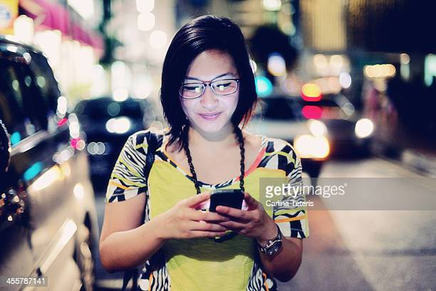 Indonesian woman on the phone at night