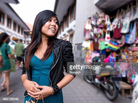 Indonesian Woman Shopping in Ubud Market Outdoors in Bali