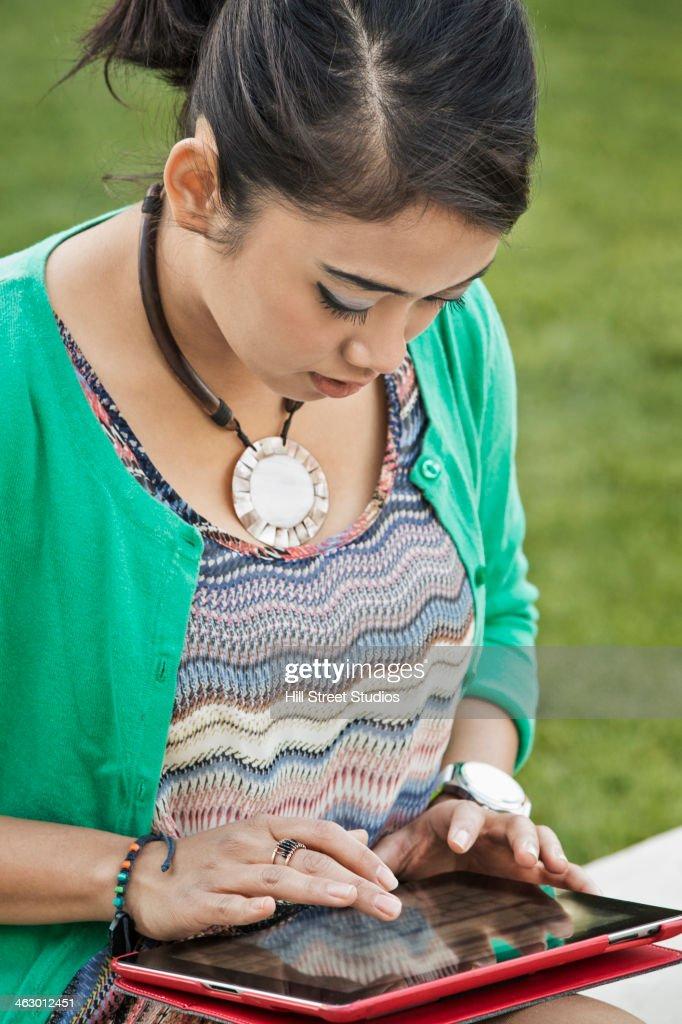Indonesian woman using digital tablet : Stock Photo