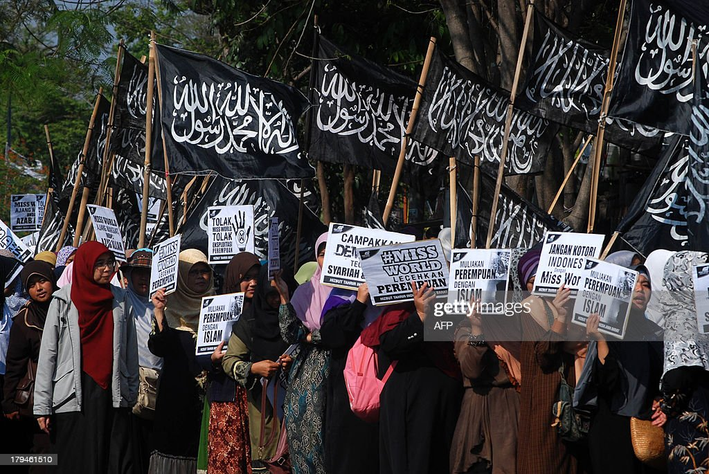 Indonesian women belonging to Indonesia's Islamic conservative organisation Hizbut Tahrir rally against the Miss World beauty pageant in Bandung city in western Java island on September 4, 2013 as Miss World 2013 contestants began arriving in Indonesia's resort island of Bali in time for the month long program. Anti-Miss World protest continue in the Muslim-majority nation ahead of the opening ceremony in Bali on September 8, 2013 in Bali and the finals in Sentul on September 28.