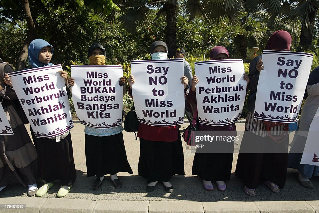 Indonesian women belonging to various Islamic conservative groups hold placards during a rally against the Miss World beauty pageant in Surabaya in eastern Java island on September 4, 2013 as Miss World 2013 contestants began arriving in Indonesia's resort island of Bali in time for the month long program. Anti-Miss World protest continue in the Muslim-majority nation ahead of the opening ceremony in Bali on September 8, 2013 in Bali and the finals in Sentul on September 28.