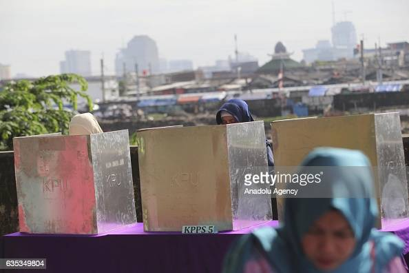Indonesian women cast their ballots during election day to elect Jakarta Governor to a fiveyear term in Jakarta Indonesia on February 15 2017...