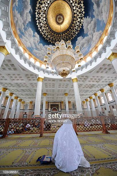 Indonesian women conduct Friday prayers at the Goldendomed Dian Al Mahri mosque for the tenth day of Ramadan in Depok on August 20 2010 The Dian Al...