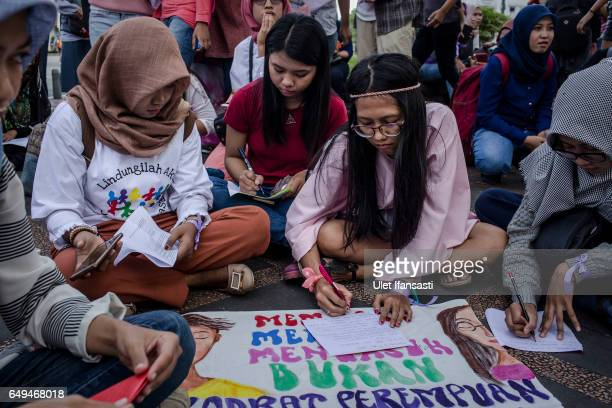 Indonesian women write letter as they celebrates International Women's Day on March 8 2017 in Yogyakarta Indonesia International Women's Day was...