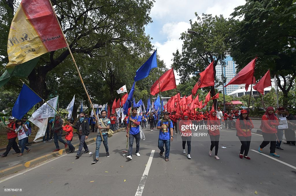 Indonesian workers and activists participate in a rally to mark May Day in Jakarta on May 1, 2016. Labourers and activists around the world marked international worker's day with marches demanding better working conditions, welfare and higher wages. / AFP / ADEK