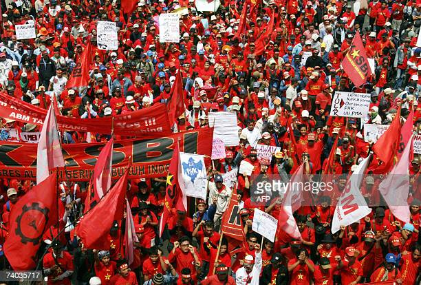 Indonesian workers march to the Presidential Palace during a May Day rally in Jakarta 01 May 2007 About 1500 protests gathered to mark May Day and...