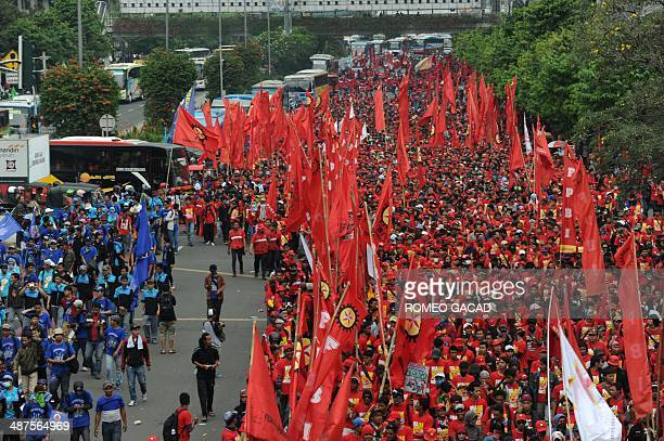 Indonesian workers rally in Jakarta to mark May Day also known as Labour Day on May 1 2014 Unions said up to two million workers would be out in...