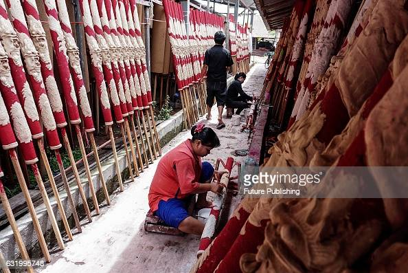 Indonesian workers seen processing incense sticks at a local factory ahead of Chinese Lunar new year's day celebrations on January 16 2017 in North...