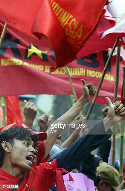 Indonesian workers shout slogans during a May Day rally in Jakarta 01 May 2007 About 1500 protests gathered to mark May Day and demand the government...