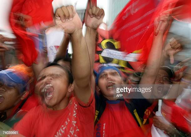 Indonesian workers shout slogans during a May Day rally in Jakarta 01 May 2007 About 1500 protesters gathered to mark May Day and demand the...