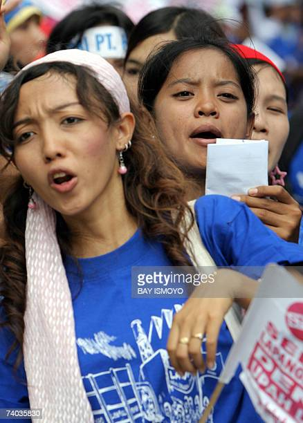 Indonesian workers shout slogans during a May Day rally in Jakarta 01 May 2007 Tens of thousands of workers were assembling across Indonesia to mark...