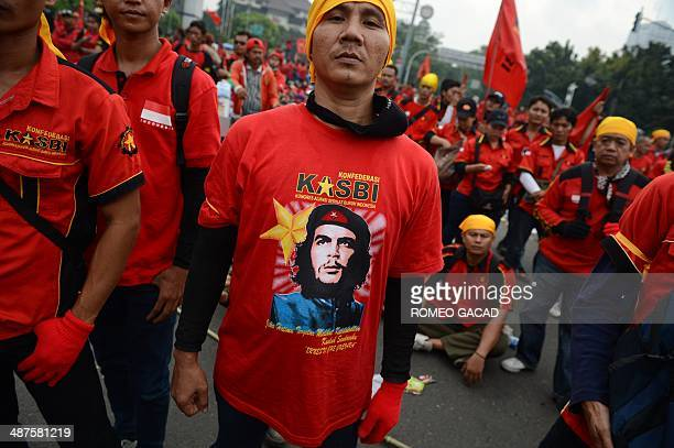 Indonesian workers wearing red shirts with portraits of revolutionary Che Guevara rally outside the presidential palace in Jakarta to mark May Day...