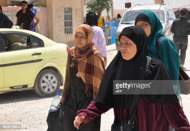 Indonesians arrive at the Ain Issa camp 50 kilometres north of Raqa after fleeing the Islamic State group's Syrian bastion on June 13 2017 When Leefa...