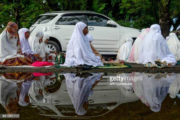 TOPSHOT Indonesians attend an Eid alAdha prayer in Padang West Sumatra province on September 1 2017 Muslims in Indonesia are celebrating Eid alAdha...