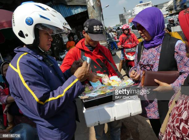 Indonesians buy Eid cards in Jakarta on June 20 ahead of the Eid alFitr festival on June 25 Muslims throughout the world will celebrate the Eid...