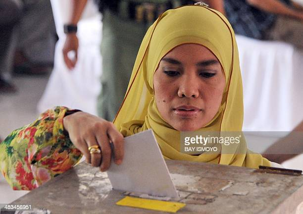 Indonesians cast at polling station during the legislative election in Jakarta on April 9 2014 Indonesians vote in parliamentary polls expected to...