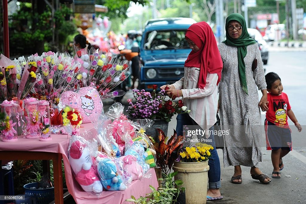 Indonesians look for roses and toys at a traditional flower market during Valentines Day. Roses, chocolates, Teddy Bears, Hello Kitty, heart toys, candles, and cards are all parts of the Valentines Day and orders increase significantly in the weeks leading up to the Valentines Day which celebrated on February 14th.
