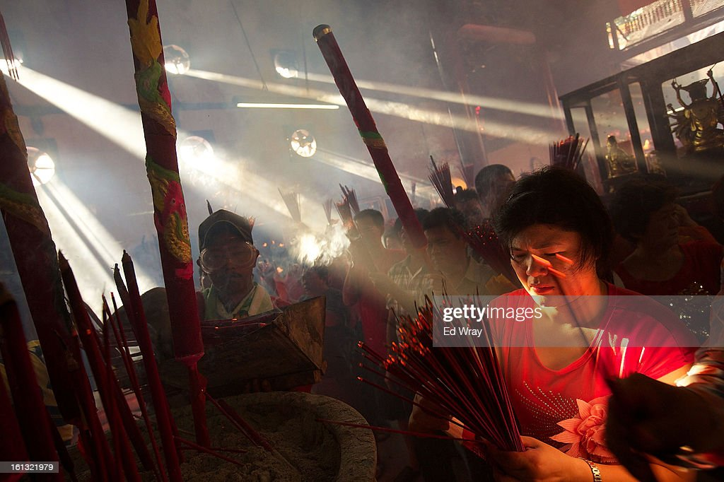 Indonesians of Chinese descent pray in the smoke filled Vihara Dharma Bhakti temple on the first day of the Chinese Lunar New year February 10, 2013 in Jakarta, Indonesia. Chinese people around the world are ushering in the Year of the Snake with prayers, feasts and fireworks..