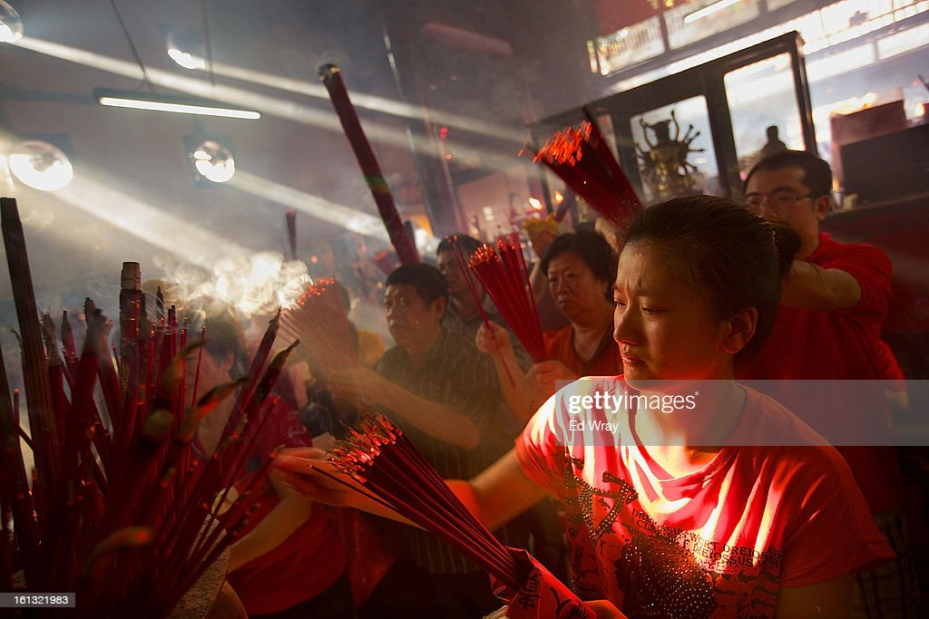 Indonesians of Chinese descent pray in the smoke filled Vihara Dharma Bhakti temple on the first day of the Chinese Lunar New year February 10, 2013 in Jakarta, Indonesia. Chinese people around the world are ushering in the Year of the Snake with prayers, feasts and fireworks.