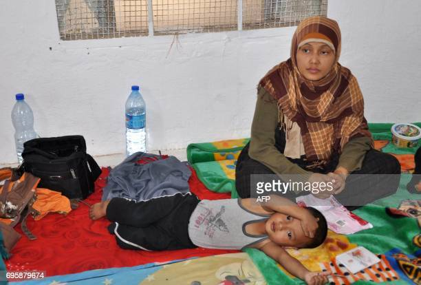 Indonesians rest at the Ain Issa camp 50 kilometres north of Raqa following their arrival after fleeing the Islamic State group's Syrian bastion on...