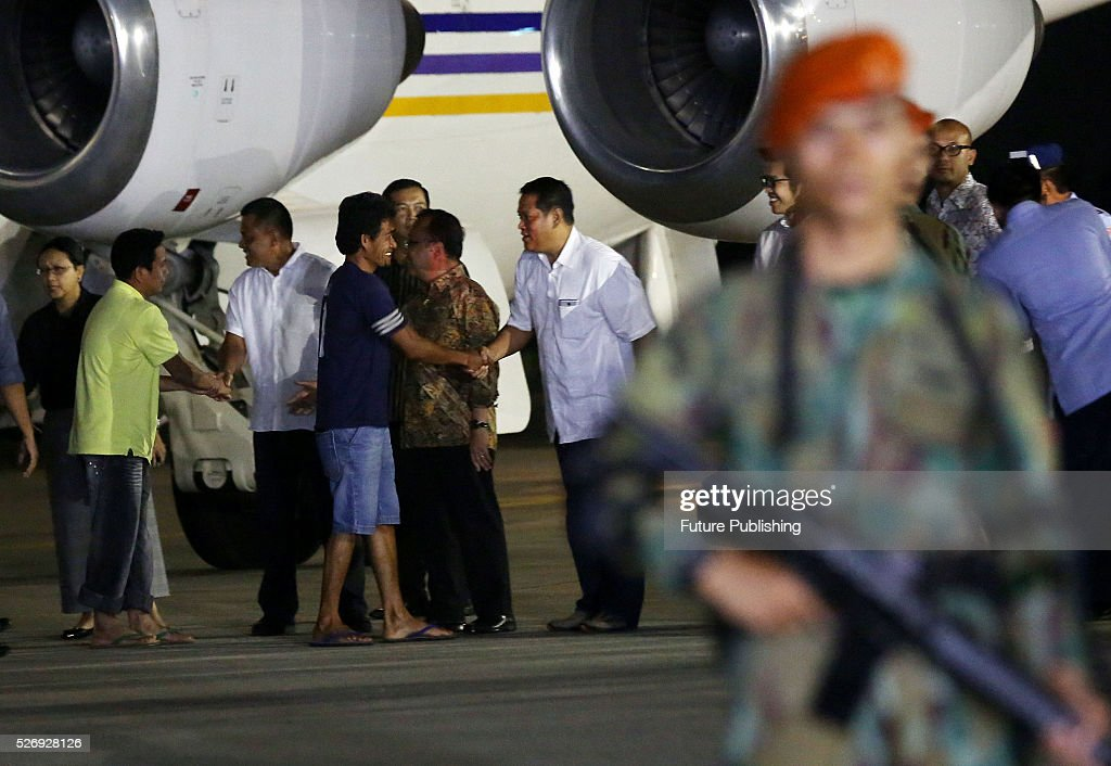 Indonesians tugboat crewmen who were taken hostage by Abu Sayyaf militants in the Philippines disembark their plane upon arrival at Halim Perdanakusuma Airbase on May 01, 2016 in Jakarta, Indonesia. The militant group has freed the 10 men who were kidnapped at sea in March in the first of three attacks on tugboats that have sparked a regional maritime security alarm. Jefta Images / Barcroft Images hello@barcroftmedia.com - +1 212 796 2458 +91 11 4053 2429