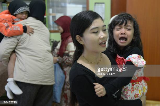 STORY 'IndonesiareligionIslamhealthwomenrightsFEATURE' by Arlina Arshad This picture taken on February 10 2013 shows Indonesian mother Desi taking...
