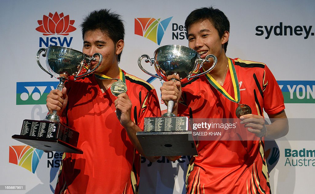 Indonesia's Angga Pratama (L) and Rayan Agung Saputra celebrate with their trophies after defeating Mohammad Ahsan and Hendra Setiawan of Indonesia in the men's doubles final at the Yonex Australian Badminton Open in Sydney on April 7, 2013. AFP PHOTO / Saeed KHAN USE