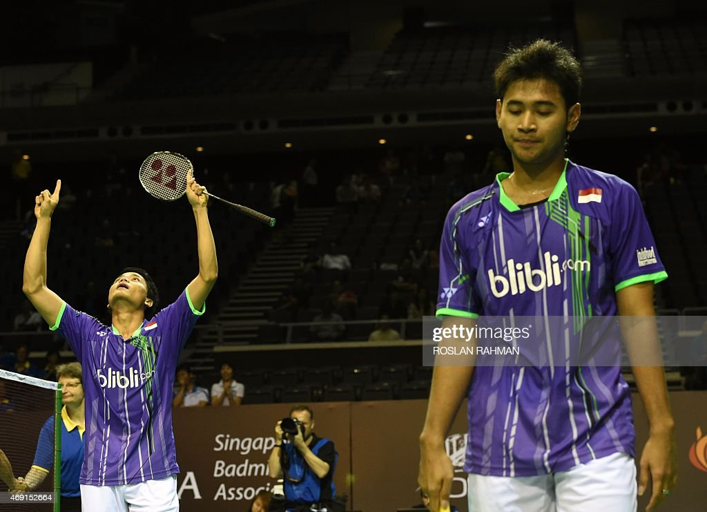 Indonesia's Angga Pratama (L) and Ricky Karanda Suwardi (R) reacts after defeating South Korea's Lee Yong Dae and Yoo Yeon Seong in their men's double quarter-finals of the Singapore Open on April 10, 2015.