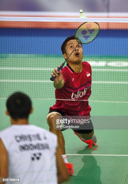 Indonesia's Anthony Sinisuka Ginting returns a shot against Indonesia's Jonatan Christie during the men's singles final match at the Korea Open...