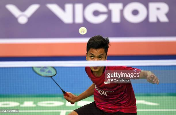Indonesia's Anthony Sinisuka Ginting returns a shot against South Korea's Son WanHo during their men's singles semifinal match at the Korea Open...